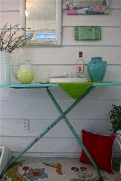 spray paint an old ironing board and you have a make shift bar.