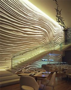 Moss & Lam's 'Wave Wall' for the W Hotel's Blue Fin Restaurant in New York is perhaps their most famous work. Inspired by the restaurant's seafood theme, a double-height wall of hand-carved, Gobi plaster waves intrinsically merges with Yabu Pushelberg's interior design.