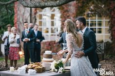 Bride and groom cutting the cheese wheel wedding cake! Garden wedding at Milton Park, Bowral NSW