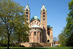 ROMANESQUE - ARCHITECTURE - Imperial Cathedral of Speyer - from the east - Begun 1030 - completed a century later. Westwork - exterior consists of multiple stories between two towers. Eastern grouping of crossing tower (junction of 4 arms-cruciform church) - also paired stair towers. Tall proportions - great in scale. Nave has generous clerestory - was planned for wooden roof. Was divided into square bays during 12th century - covered w/heavy unribbed groined vaults. LOCATION: RHINELAND…