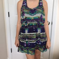 Weekend sale!! Priced to sell dress Medium tank dress. A few runs in fabric. Not too noticeable. Cinched waist. Fun and flirty. Xhilaration Dresses