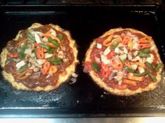 Paleo pizzas made with a cauliflower crust recipe pulled from Pinterest.