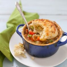 VEGETARIAN POT PIE -  As wonderful as the filling is, I love the biscuit topping even more. They are so tender and buttery, and the addition of Feta and scallions makes them irresistible. Our whole family loved this meal and we definitely didn't miss the meat one bit.  http://goboldwithbutter.com/?p=2919#