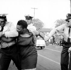 """Woman resisting arrest Birmingham, Alabama, April 14, 1963 Unidentified photographer From """"Freedom Now! Forgotten Photographs of the Civil Rights Struggle"""" by Martin A. Berger"""