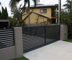 Clean lines aluminum -- http://www.homeepiphany.com/21-totally-cool-home-fence-design-ideas/2/
