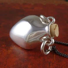 Hey, I found this really awesome Etsy listing at https://www.etsy.com/listing/187833850/amphora-necklace-antique-silver-bottle