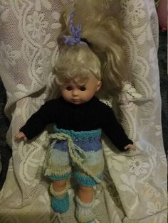 Hannah is modelling my knitted dolls clothes and she is not for sale. Today she is wearing a black jumper, multi coloured skirt and boots. I used double knit acrylic wool. Black Jumper, Acrylic Wool, Knitted Dolls, Double Knitting, Doll Clothes, Baby, Newborn Babies, Infant, Baby Baby