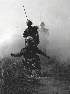 Out of the mist, U.S. Army troops move through a rice paddy south of Saigon, Vietnam | Flickr - Photo Sharing!