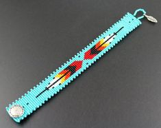 Two Feathers...Native American by CabinFeverBracelets on Etsy