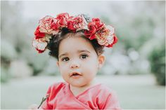 Miami Fine Art Photography. First birthday floral portraits by Aurora Photography. Jasmin's portraits feature a beautiful red dress and fresh floral crown.