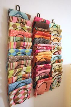 If you're a quilter or like to sew, store your fabric collection in wall-mounted magazine holders.