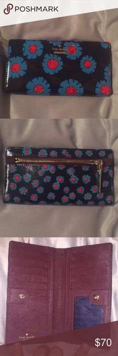 Kate spade flowered Stacy wallet Kate spade flower print Stacy wallet - base is navy blue with bright blue and red flowers.  Inside is wine colored leather   13 card holders, 4 bill sections and a change section on the back side kate spade Bags Wallets