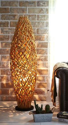 Great Unique Wooden Floor Lamp! Made from high quality wood branches, assembled with great craftmanship. With a natural look , this Masterpiece looks gorgeous and creates ambiance environment, brighten your days with interesting lights. It's great when place on one side of your couch and a wooden side table or stump on another. Find more Creative Ideas from O'THENTIQUE's Designer on our site!