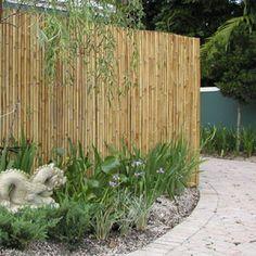 This rolled bamboo screen makes an easy method of hiding garden eyesores or creating smaller garden rooms within a Japanese garden. From Safari Thatch.