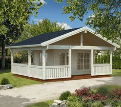 The larger of two immensely impressive garden buildings, the Agneta x Cottage has an extended porch that runs around the side of this superb structure. Bungalows, Log Wall, Roofing Options, Roof Overhang, Window Glazing, Stainless Steel Doors, Garden Buildings, Flat Roof, Roof Design