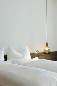 Hotel Wiesergut- love the bedding and the bedside lamp