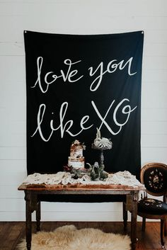 Bold black and white wedding banner for the cake station | Image by Peyton Rainey Photography and Chelsea Denise Photography