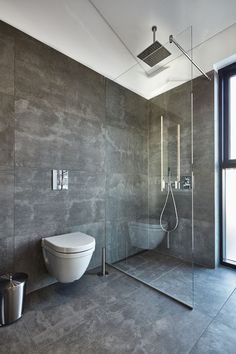 If you have a small bathroom in your home, don't be confuse to change to make it look larger. Not only small bathroom, but also the largest bathrooms have their problems and design flaws. Bathroom Glass Wall, Concrete Bathroom, Bathroom Renos, Grey Bathrooms, Bathroom Layout, Small Bathroom, Bathroom Ideas, Shower Ideas, 1950s Bathroom