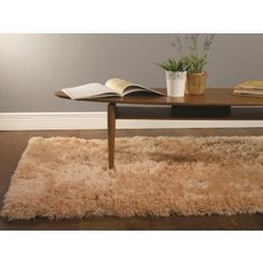 Beige Sheepskin Rug. This rug has a 8.1cm pile ensuring a super soft feeling. The shaggy style rug is a homeowners favourite. http://www.therughouse.co.uk/sheepskin-rugs