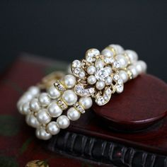 $85.00 from Etsy.... OMG I WANT THIS SO BAD!!! Pearl Bridal Bracelet, Gold Wedding jewelry, Vintage Rhinestone Flower, Swarovski Rhinestone and Pearl, Triple Strand, SABINE CLASSIC