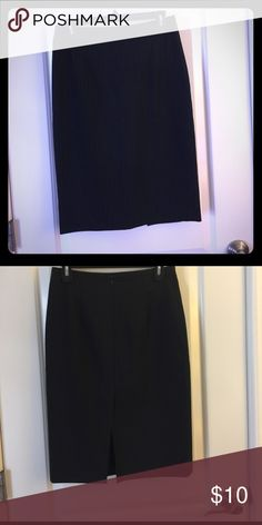 Black pinstripe high waist pencil skirt. Fitted high waist black pencil skirt with Thin blue pin stripe. Skirt has slit up the back and falls just below the knee Skirts Midi