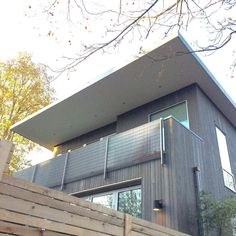 The smooth plaster soffit goes great with the wood siding on this modern style home