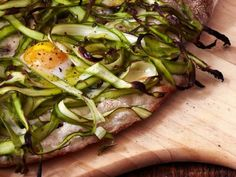 Jim Lahey's bird nest pizza with shaved asparagus and eggs, he calls for quail's eggs but small eggs would work.