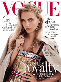 British model Cara Delevingne wearing a Burberry trench coat on the cover of the October issue of Vogue Australia