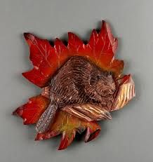 Image result for wooden hand  carved and painted maple leaf