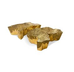 Made in melted metal and gold plated, Eden center table represents a part of the tree of knowledge and the tale of the birth of desire.