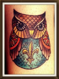 Owl tattoo...but with a peace sign on the belly