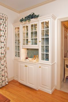 built-in China cabinet by Justin deGast, via Flickr --glass front top, White ext, painted int, open bar/serving area