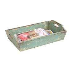 With inset handles, this deep wooden tray makes a wonderful catch-all near the front door. Its trendy minty-green shade is stylishly distressed for a rustic look.