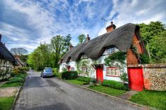 What makes a cottage so distinctive from other small homes is its dark thatched roof, and the way it envelops the cottage like melted cheese.(funny how cottage cheese looks nothing like this) These. Thatched House, Thatched Roof, Old Cottage, Cottage Homes, Brick Cottage, White Cottage, Cottage Design, Cottage Style, Cottages England