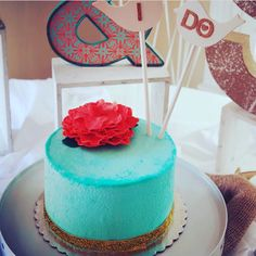 Beautiful teal cake with a coral flower for our LOVE BIRDS wedding. Wedding decor by Imprint Affair.