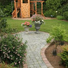 More project photos. Please see us at classicnursery.com for more info - contemporary - landscape - seattle - Classic Nursery & Landscape Co. / Alan Burke, asla... I like that the garden is still lush and there is a kid zone, I just think it should be larger.
