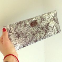 REACTION KENNET COLE snake print clutch bag Brand new no tag clutch. Man made material. Great quality!!!! Size: L 10.5in H 5in W3/4 of inch. Great buy! NYC b&w print on the inside. Kenneth Cole Bags Clutches & Wristlets