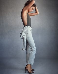 Flashing a smile, Cameron Russell wears Chloe jumpsuit, Fella swimsuit and Christian Louboutin pumps