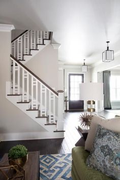 The living room enjoys an easy transition to the adjoining foyer and the staircase that leads to the home's upper level.