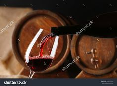 Pouring Red Wine From Bottle Into Glass With Wooden Wine Casks On Background 写真素材 248074264 : Shutterstock Wine Cask, Red Wine, Alcoholic Drinks, Bottle, Glass, Alcoholic Beverages, Drinkware, Flask, Red Wines