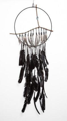 m catcher made with Black deerskin suede, aqua aura crystal, found branch, black turkey & guinea hen feath