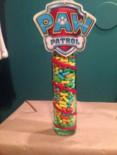 Paw patrol game for grown ups or older kids!  Guess how many!? Vase from dollar tree Mini bones from oriental trading The red string around it is also from dollar tree and the giant paw patrol is actually a tag from a paw patrol shirt I got from  target but you can always print from the web!  Thought it was neat hope you do too