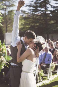 image_fist_pump_kiss_wedding first kiss at wedding wedding party blog
