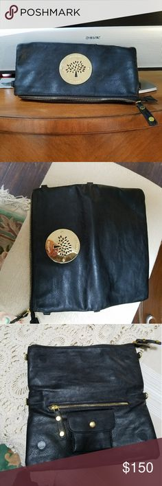 Mulberry clutch Mulberry black clutch . Comes with shoulder strap for crossbody or shoulder.  Only worn a few x's. Excellent condition. Mulberry Bags Crossbody Bags