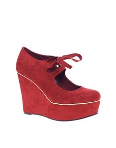 Red shoes that make me want to cry... love em. How high is the heel though... hate when they don't say.