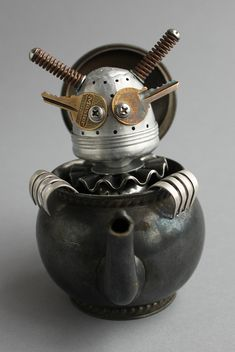 robot made from a tea strainer crawling out of a teapot. Found Object Robot Assemblage Sculpture By Brian Marshall Arte Robot, Robot Art, Robots, Recycled Robot, Recycled Art, Repurposed, Metal Tree Wall Art, Scrap Metal Art, Found Object Art