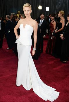 Brides.com: The Most Wedding-Worthy Red Carpet Dresses. Charlize Theron at the 2013 Oscars. Theron would look stunning wearing a paper bag, but we're thrilled that she stepped out a white Dior Couture dress with peplum, one of the hottest bridal trends. Her platinum Harry Winston jewelry—two vintage bracelets, a diamond marquise lattice bracelet, diamond studs and a marquise ring—adds megawatt glamour to the sleek look. She's just as sophisticated as ever, and we're loving her bold short ...