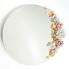 How to decorate your mirror with flowers. I'm thinking this tenchique would work well with greenery, too.