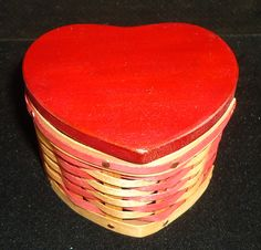 """Our Love's Treasure Box Basket is, of course, Heart shaped, created with Maple in antique brown and red weave and a red, solid wood heart shaped lid! The perfect hiding place for love notes or a gift of jewelry!  Measures 3 1/8"""" x 3"""" x 2""""  $32.00 Red Weave, Hiding Places, Treasure Boxes, Heart Shapes, Solid Wood, Baskets, Weaving, Miniatures, Notes"""