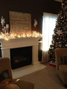 lighted mantel and I love the wood sign!---could do this over the fireplace in our house! then the christmas fairy wouldnt have to fly over to my house and decorate  :)  hahaha!